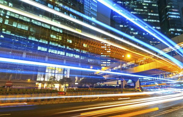 Image representing high speed data being transported across a city at night